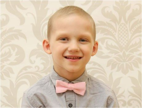 Image of Smiling Boy Wearing a Pink Bowtie