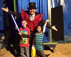 Image of Two Children with a Magician